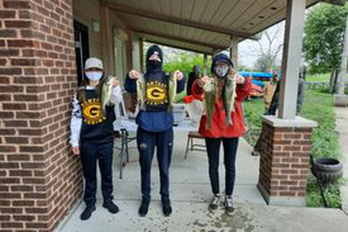 Glenbard North's all freshman, all-girl team of Kayla Summins (left), Mikaela Quinn and Pheona Phillips hold their second-place catch at theBusse Woods Reservoir (Main Pool) sectional, which earned them a trip to the state finals in IHSA bass fishing. Provided photo