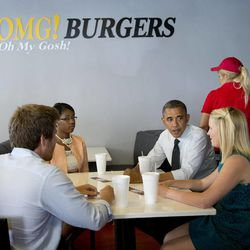 President Barack Obama visits Emily Young, right, Maximo Soler, left, and  Leslie Redmond, second from left, at OMG! Burgers, Thursday, Sept. 20, 2012, in Miami, Fla.
