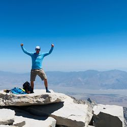 Jared White flexes triumphantly atop Mount Whitney in California earlier this summer.