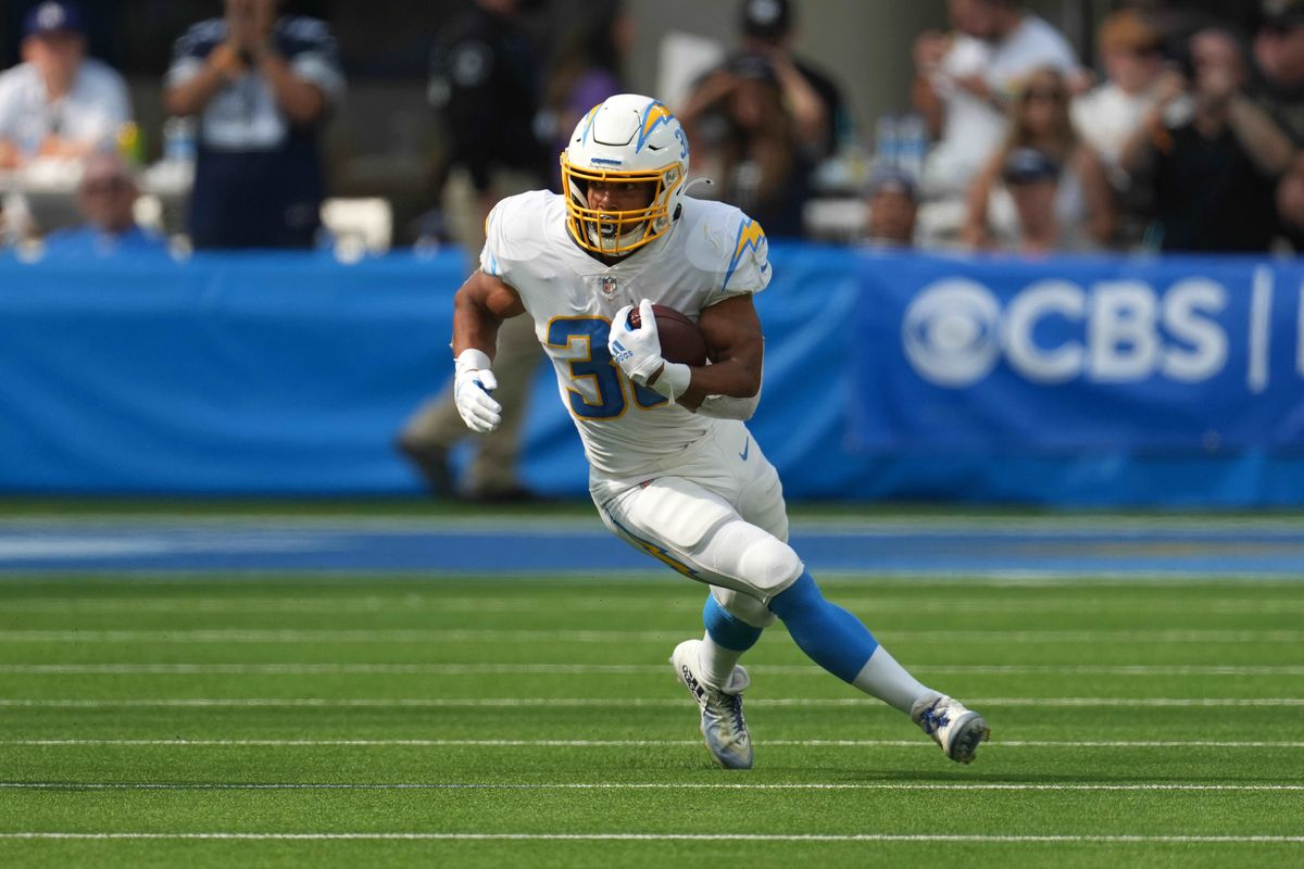 Los Angeles Chargers running back Austin Ekeler (30) carries the ball against the Dallas Cowboys in the third quarterat SoFi Stadium.