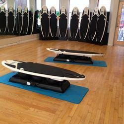 """The <strong>Surfset</strong> workout at <a href=""""http://www.sweatrepublicsf.com/"""">Sweat Republic</a> uses these stationery surfboards that simulate the movements of actual surfing. You'll use arm muscles for pushing up and your legs and core for maintaini"""