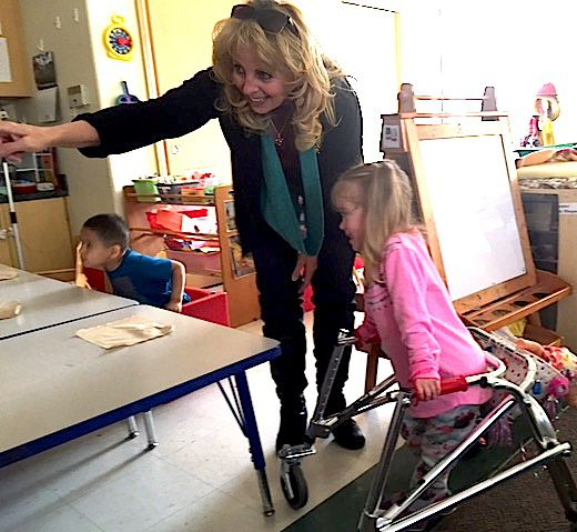 Pam Sturgeon, an early childhood mental health consultant, directs a preschooler at a Longmont child care center.