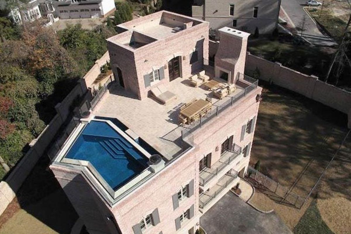 A photo of a Buckhead townhome with a rooftop pool.