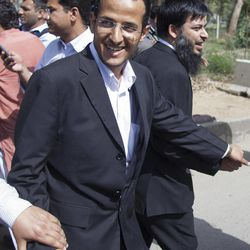 Atif Ali Khan, right, lawyer of Osama bin Laden's family escorts Zakariya Ahmad Abd Al-Fattah brother-in-law of Bin Laden, foreground, as he leaves the house where Osama bin Laden's family are being detained, in Islamabad, Pakistan, on Monday, April 2, 2012. The lawyer for Osama bin Laden's family says a Pakistani court has convicted his three widows and two of his daughters on charges of illegally living in Pakistan and sentenced them to 45-days in prison.