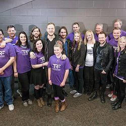 Imagine Dragons smiles with the Robinson family at the Tulsa, Okla. benefit concert on February 22.