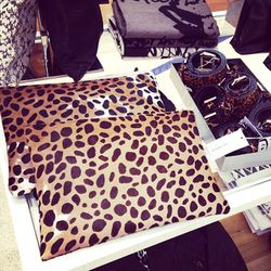 """Leopard foldover clutches by LA's <A href=""""http://la.racked.com/archives/2013/10/14/elle_fawns_over_las_eastside_experience_with_clare_vivier.php""""target=""""_blank"""">Clare Vivier</a>."""