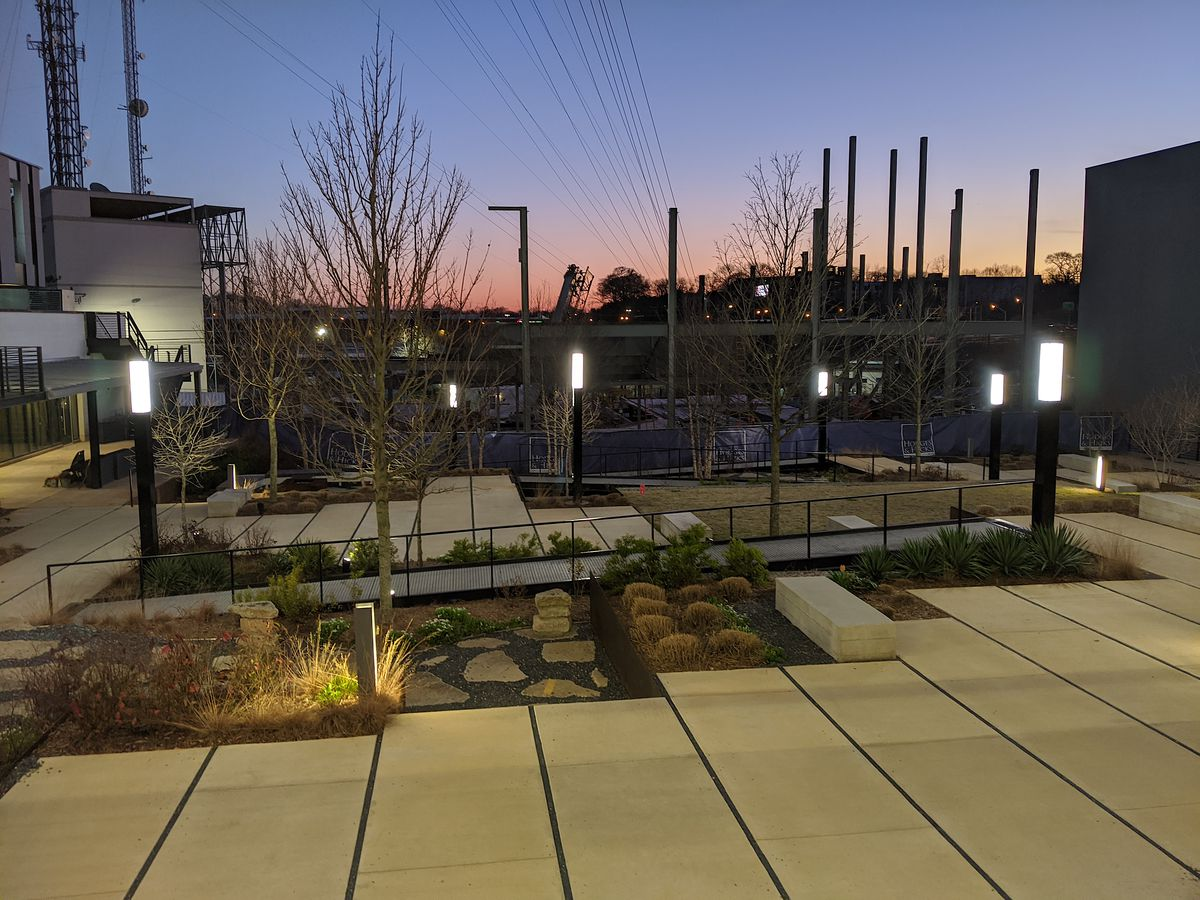 The modern, concrete-laden garden sits between the main retail part of Atlanta Dairies and the under-construction music venue.