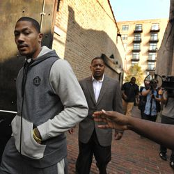 Chicago Bulls' Derrick Rose arrives for a news conference to unveil his new shoe the Adidas D Rose 3 in Chicago, Thursday, Sept. 13, 2012.