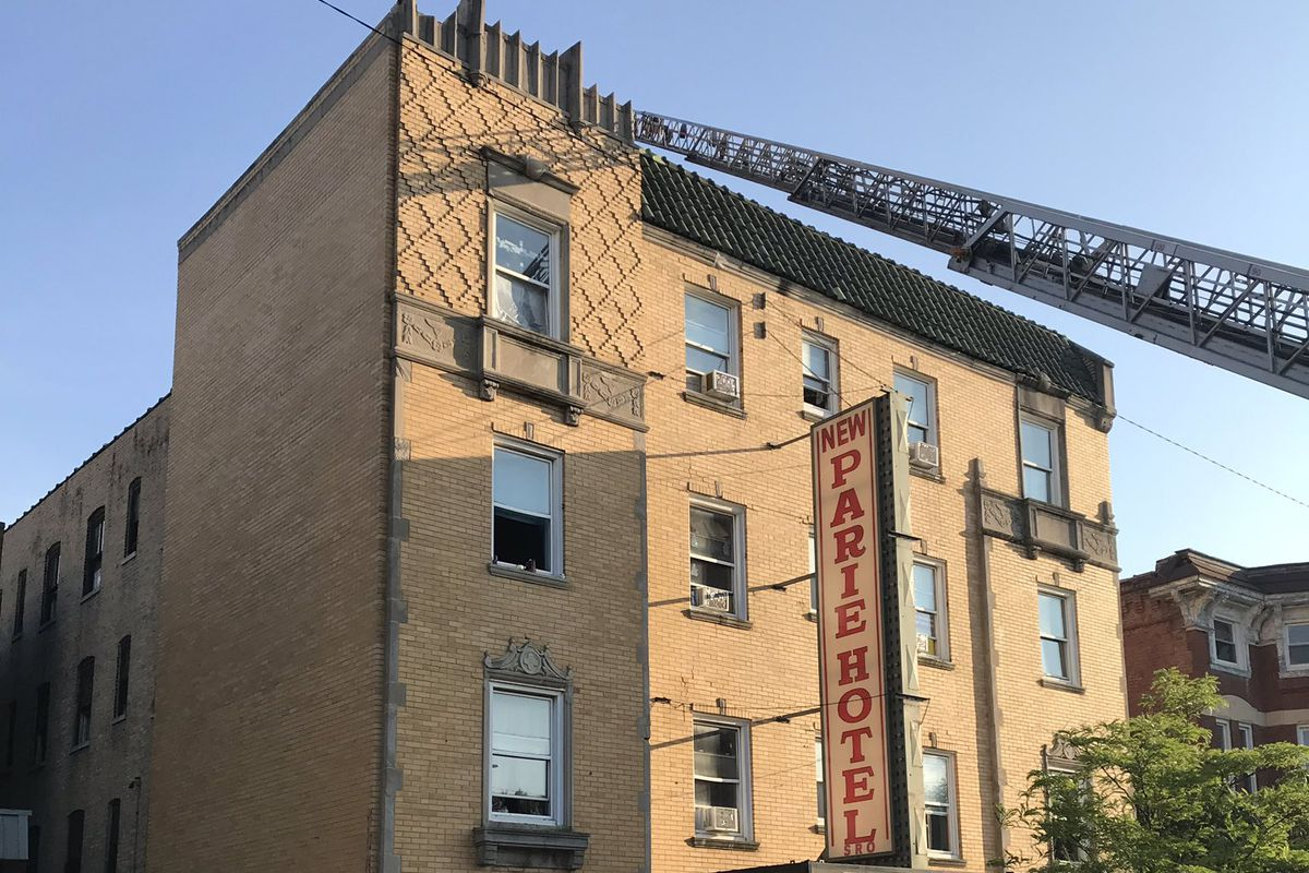 Firefighter respond to a fire Saturday at the New Parie Hotel.