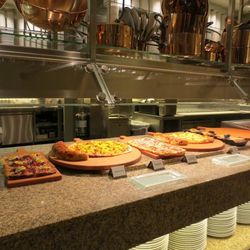 Breakfast pizzas, strombolis and quiches at Bacchanal Buffet.