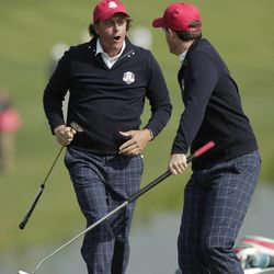 USA's Phil Mickelson and Keegan Bradley celebrate after winning their foursomes match on the 15th hole at the Ryder Cup PGA golf tournament Friday, Sept. 28, 2012, at the Medinah Country Club in Medinah, Ill.