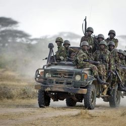 FILE - In this Monday, Feb. 20, 2012 file photo, Kenyan army soldiers ride in a vehicle at their base in Tabda, inside Somalia. Kenya's military said Friday, Sept. 28, 2012 that its troops attacked Kismayo, the last remaining port city held by al-Qaida-linked al-Shabab insurgents in Somalia, during an overnight attack involving a beach landing.