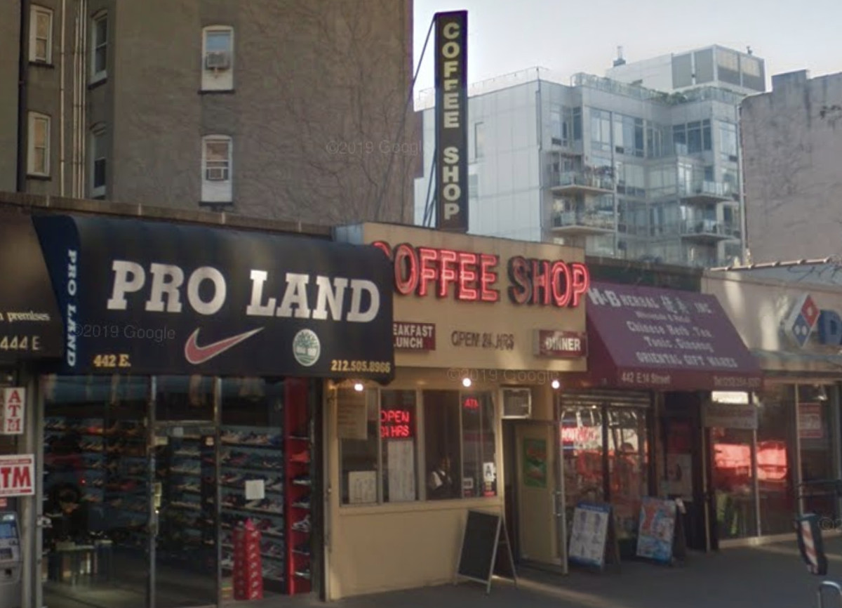 The exterior of a coffee shop on East 14th Street with a bright red neon sign