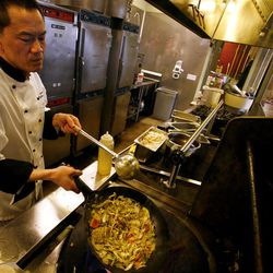 Hai Fitzgerald prepares a royal Thai stir-fry at Thyme and Seasons Restaurant in Bountiful on Monday, April 9, 2012.