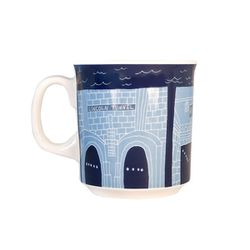 """For the one who commutes from Jersey:  <b>Fishs Eddy</b> Bridge & Tunnel mug, <a href=""""http://www.fishseddy.com/browse.cfm/4,3227.html"""">$12.95</a>"""