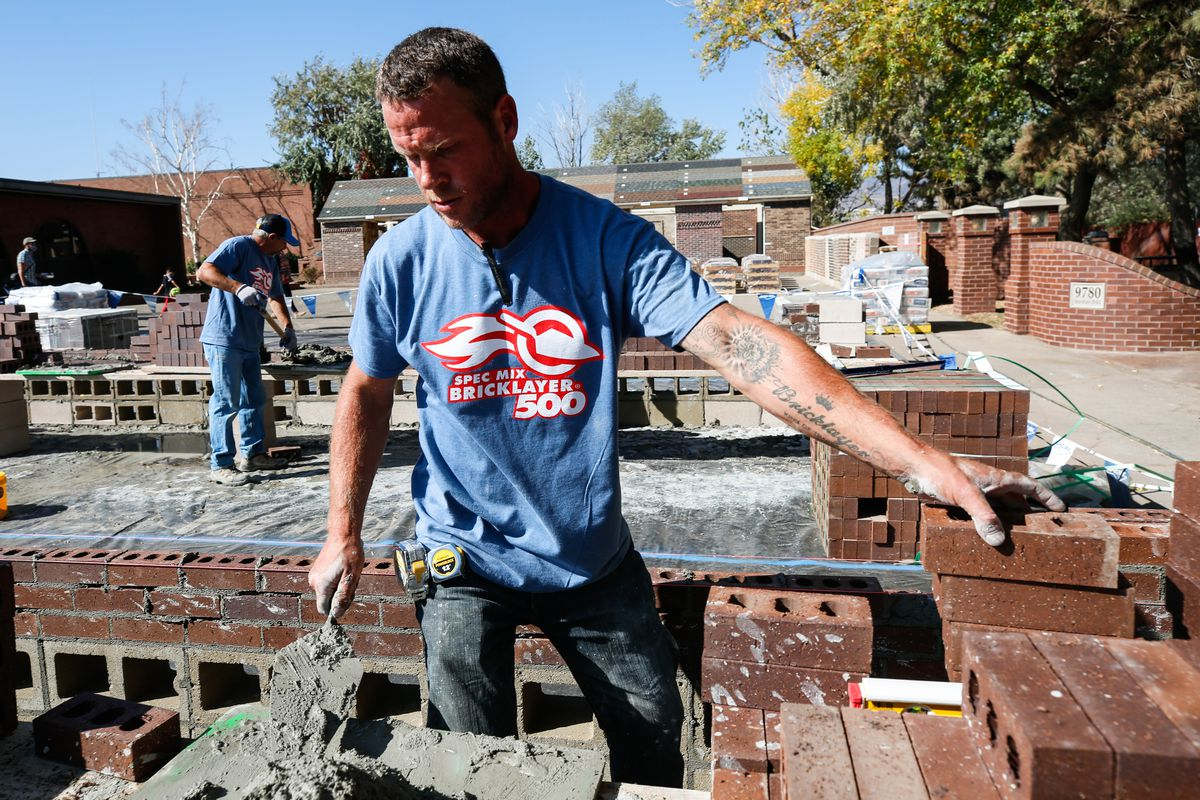 Klayton Kidrick grabs a brick while competing in the Spec Mix Bricklayer 500 regional competition at Interstate Brick in West Jordan on Friday, Oct. 9, 2020.