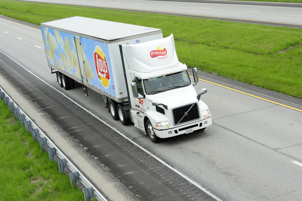 A Frito-Lay truck on the road.