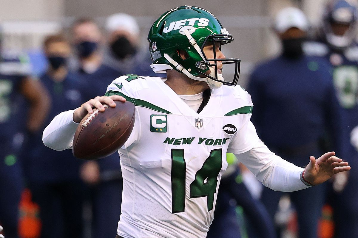 Sam Darnold #14 of the New York Jets looks to throw the ball in the third quarter against the Seattle Seahawks at Lumen Field on December 13, 2020 in Seattle, Washington.