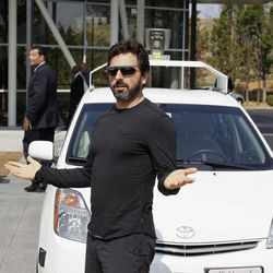 Google co-founder Sergey Brin gestures after riding in a driverless car with California Gov. Edmund G Brown Jr., left, and state Senator Alex Padilla, second from left, to a bill signing for driverless cars at Google headquarters in Mountain View, Calif., Tuesday, Sept. 25, 2012.  The legislation will open the way for driverless cars in the state. Google, which has been developing autonomous car technology and lobbying for the legislation has a fleet of driverless cars that has logged more than 300,000 miles (482,780 kilometers) of self-driving on California roads.