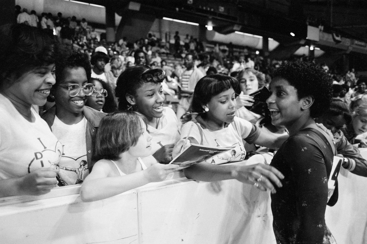 Dianne Durham gives autographs after winning the women's title at the McDonald's U.S.A. Gymnastic Championships at the University of Illinois in Chicago in 1983. Durham died Thursday at age 52.