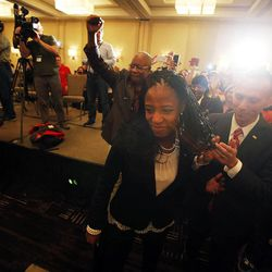 Mia Love, 4th Congressional District Republican candidate, is followed by her husband, Jason, as she walks to the stand to declare victory on election night in Salt Lake City, Tuesday, Nov. 4, 2014.