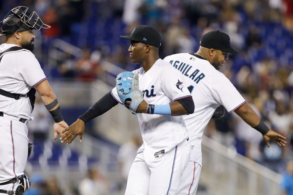 Miami Marlins right fielder Jesus Sanchez (center) celebrates with catcher catcher Sandy Leon (left) after winning the game against the Cincinnati Reds at loanDepot Park