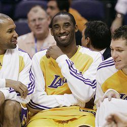 Common logic might have you believe that Kobe Bryant, center, does more to help his team win than Luke Walton. Statistics would tell you different.