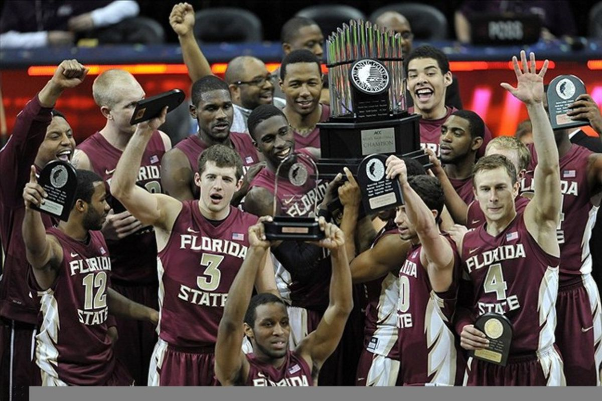 March 11, 2012; Atlanta, GA USA; The Florida State Seminoles celebrate their win of the 2012 ACC Men's Basketball Tournament at Philips Arena. Florida State won 85-82. Mandatory Credit: Paul Abell-US PRESSWIRE
