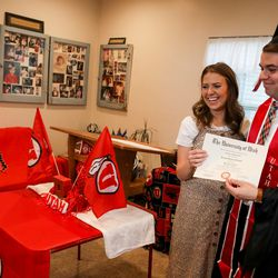 Ceciley Hallman Herod presents her brother Joseph Hallman with a copy of a diploma during a mock commencement ceremony in their parents' Sugar House home amid the COVID-19 pandemic on Thursday, April 30, 2020. Joseph Hallman earned bachelor's degrees in Latin American studies, Spanish and international business with an emphasis in trade commerce in 2019 with hopes of walking during the spring 2020 commencement ceremony.