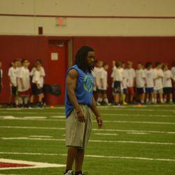 Wisconsin wide receiver Kenzel Doe looks on.