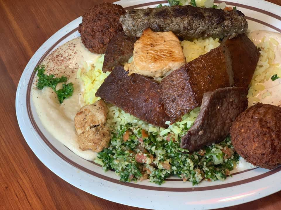 Middle Eastern combo platter with meats, spreads, and salads