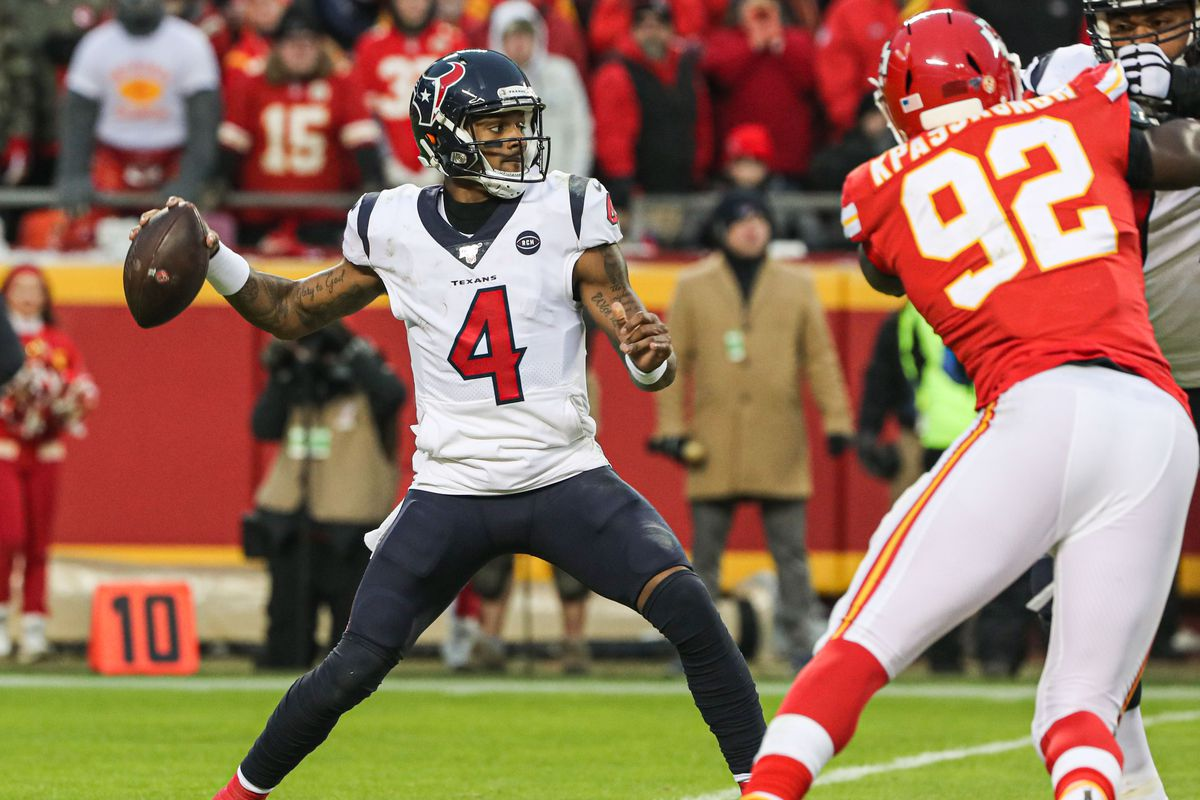 Houston Texans quarterback Deshaun Watson throws a pass as Kansas City Chiefs defensive end Tanoh Kpassagnon defends during the second half in a AFC Divisional Round playoff football game at Arrowhead Stadium.