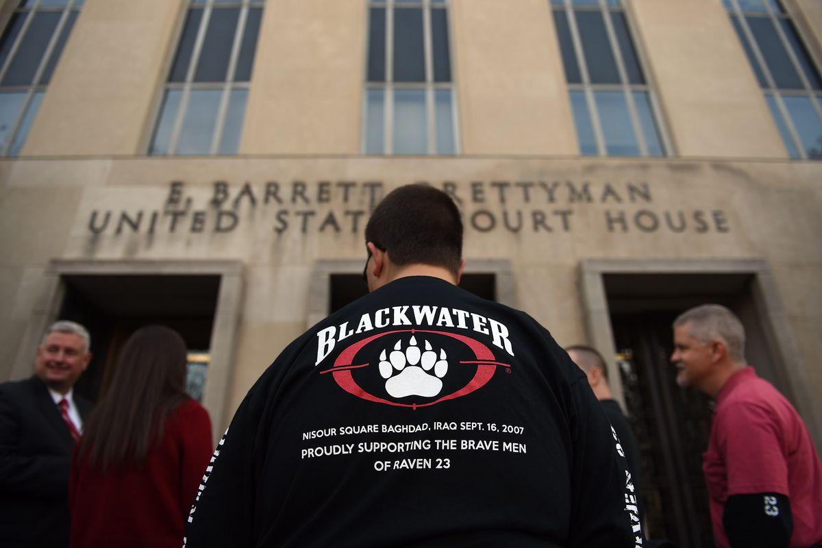 Supporters of the four Blackwater employees gather outside the federal courthouse on the day of the sentencing.