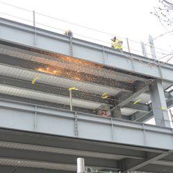 2:10 p.m. Welding sparks being blown around by the wind -