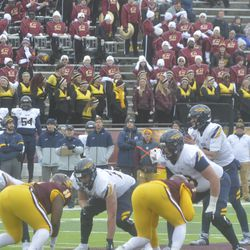 Carter Bradley and the Toledo offense set up in front of the CMU Marching Band.