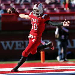 Cole Peterson of East runs in for a touchdown against Springville during 4A semifinal high school football in Salt Lake City, Thursday, Nov. 12, 2015.
