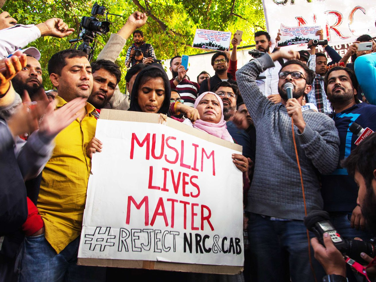 """A protester holds a sign that says """"Muslim Lives Matter #Reject NRC&CAB"""" in New Delhi, India."""