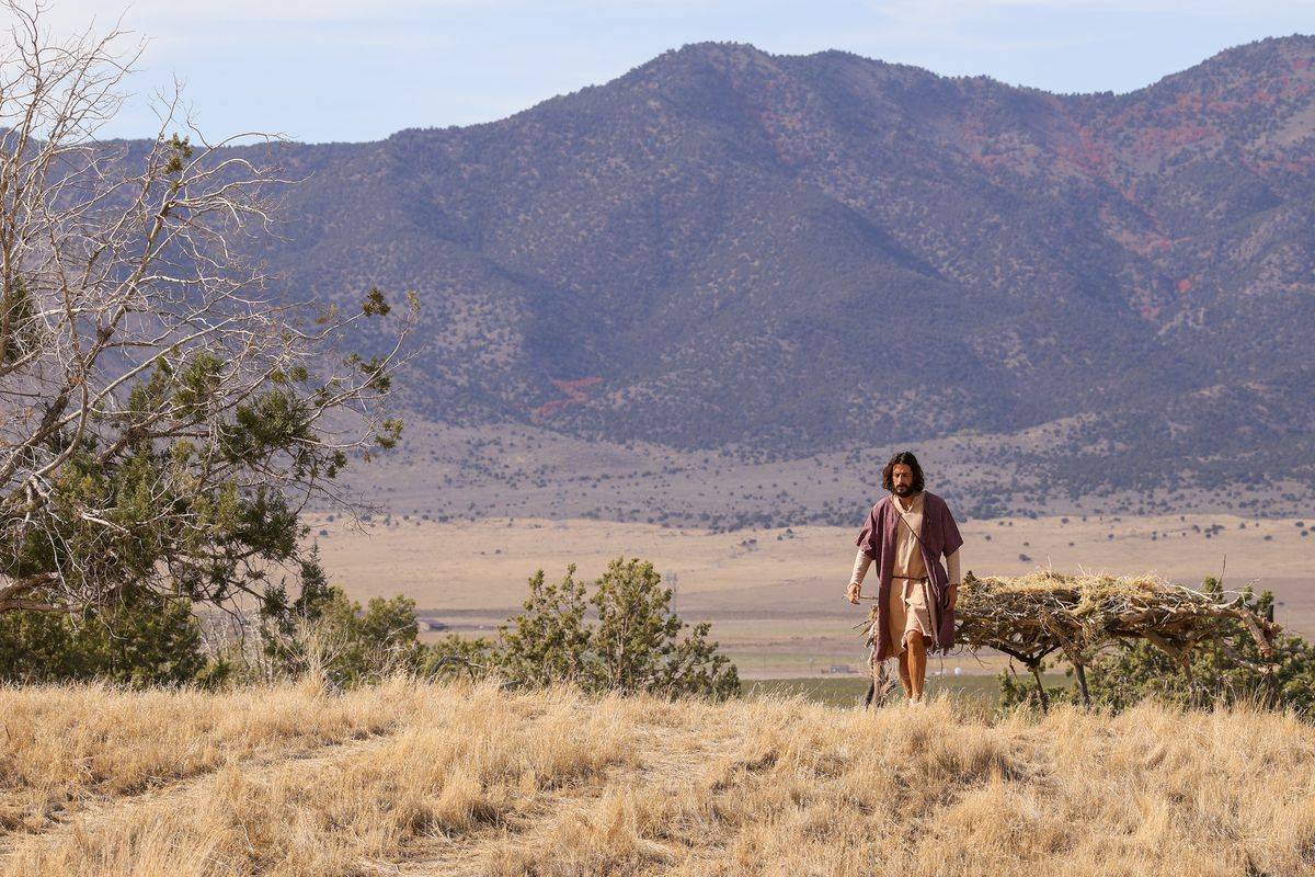 """Jonathan Roumie, wh plays Jesus, walks toward trailers during filming of a faith-based streaming series on the life of Jesus Christ called """"The Chosen"""" at The Church of Jesus Christ of Latter-day Saints' Jerusalem set in Goshen, Utah County, on Monday, Oct. 19, 2020."""