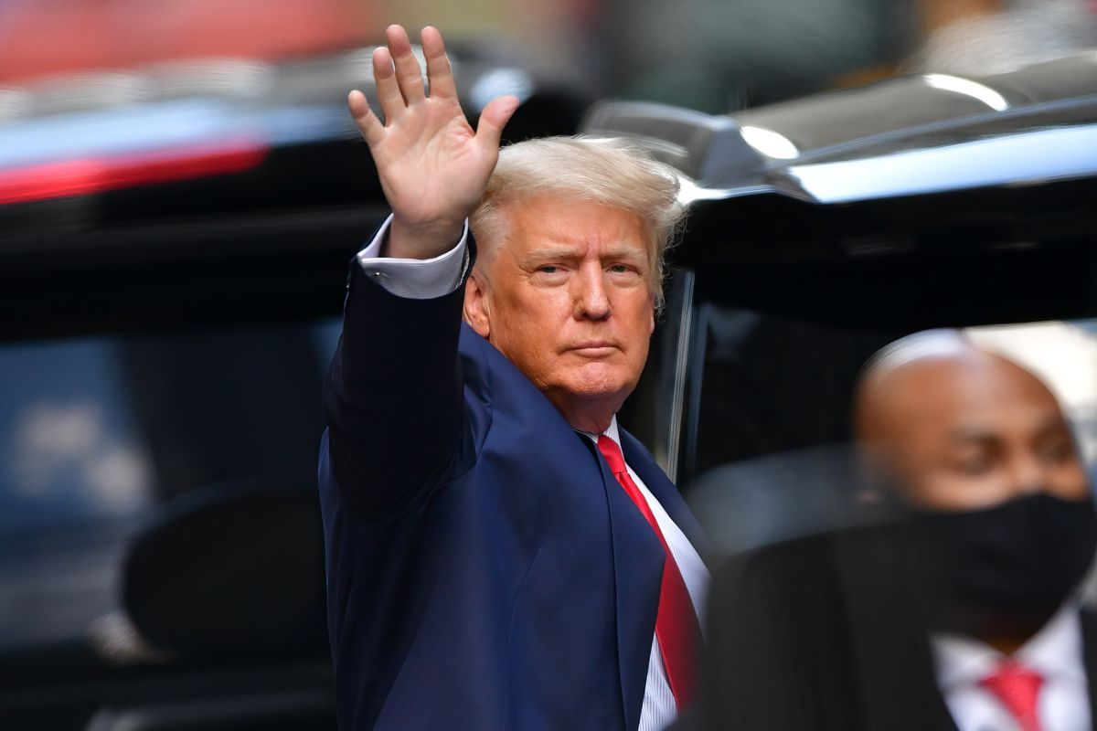Former president Donald Trump waves as he heads toward his car after exiting Trump Tower in Manhattan on May 18, 2021, in New York City.