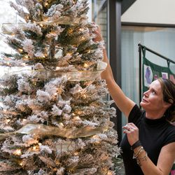 Keri Stephens, whose son Anthony Whitaker donated organs and tissue after he died, hangs an ornament on a Christmas tree at a ceremony hosted by Intermountain Donor Services in Salt Lake City on Wednesday, Dec. 21, 2016.