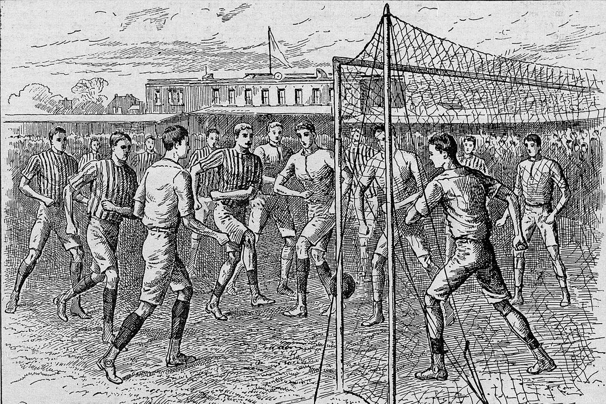 Victorian era men engaged in an outdoor soccer gam