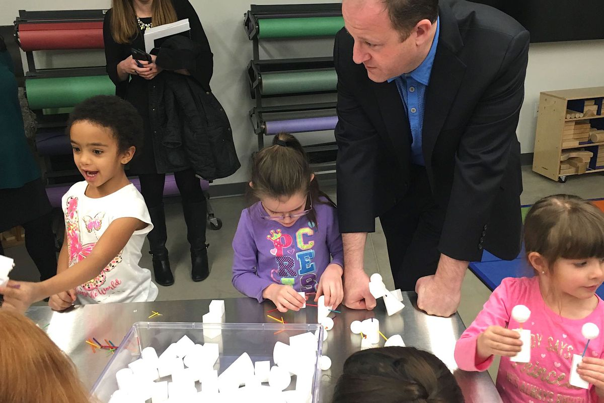Colorado Gov. Jared Polis visits with preschoolers at the Maddox early childhood center in the Englewood school district in early 2019.
