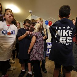 Children dressed in Mike Lee T-shirts wait in line for food at an election night party for Sen. Mike Lee, R-Utah, in South Jordan on Tuesday, Nov. 8, 2016.