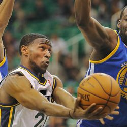 Utah's Ian Clark flips up a shot with Warriors' Stephen Curry and Draymond Green defending as the Utah Jazz and the Golden State Warriors play Tuesday, Oct. 8, 2013 in preseason action at Energy Solutions arena in Salt Lake City.
