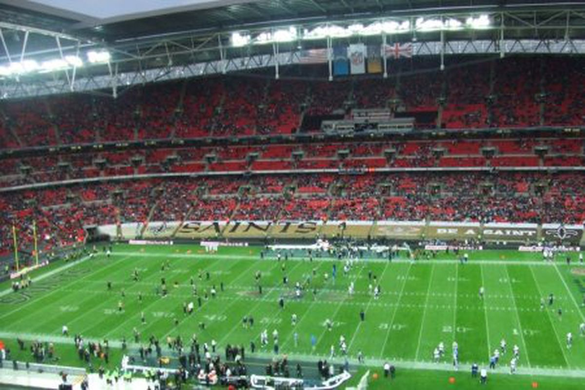 <em>Saints and Giants warm up for their 2008 NFL game at Wembley Stadium in London.</em>