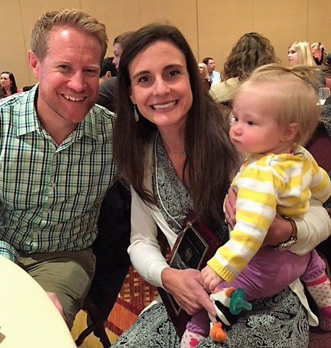 Cameran Simpson, a bilingual school psychologist in Aurora Public Schools, with her husband, Kent, and her daughter, Willow.