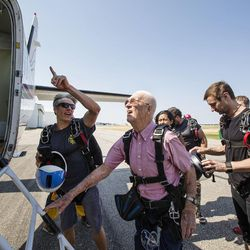 Scotty Freeland, left, offers advice to Wendell Ashcroft about watching his head when he climbs into the plane at Skydive Ogden in Ogden on Saturday, Aug. 5, 2017.
