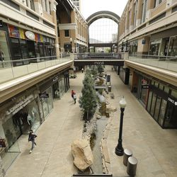 A few people walk through the City Creek Center in Salt Lake City on Wednesday, May 6, 2020. The shopping center reopened Wednesday.