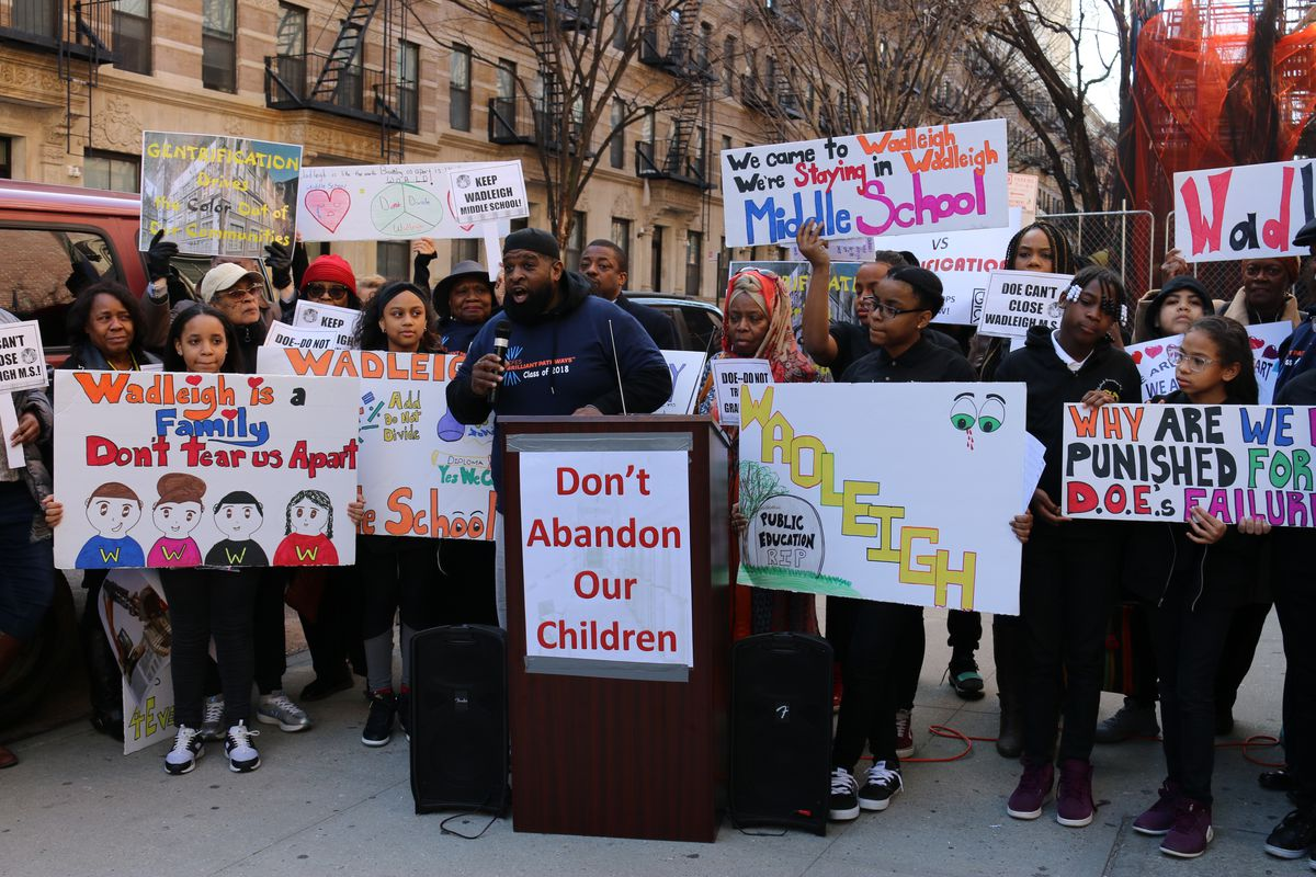 A Wadleigh graduate addresses the crowd at a rally outside the school. Students, parents and community leaders spoke against the city's plans to close the Harlem performing arts school.
