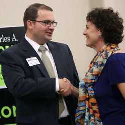 Charles Stormont, Democratic candidate for Utah attorney general, shakes hands with Chelsie Acosta at the Utah Education Association Convention and Education Exposition at the South Towne Expo Center in Sandy on Thursday, Oct. 16, 2014.